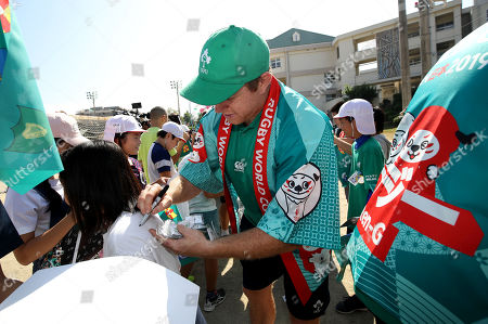 Stock Image of Sean Cronin signs autographs for children from the school