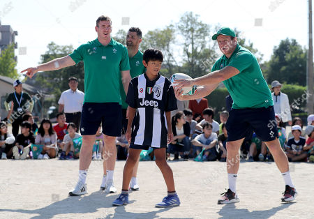Chris Farrell, Rob Kearney and Sean Cronin play rugby with the school children