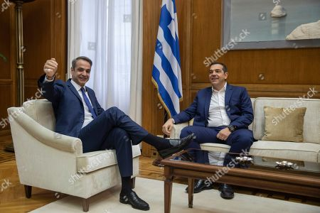 Stock Photo of Kyriakos Mitsotakis, Alexis Tsipras. Greek Prime Minister Kyriakos Mitsotakis, left, gestures during his meeting with Syriza party leader Alexis Tsipras, in Athens, on