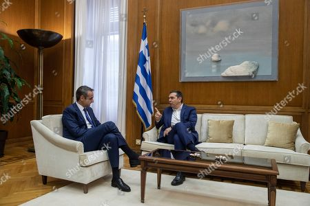 Kyriakos Mitsotakis, Alexis Tsipras. Greek Prime Minister Kyriakos Mitsotakis, left, speaks with Syriza party leader Alexis Tsipras during their meeting in Athens, on