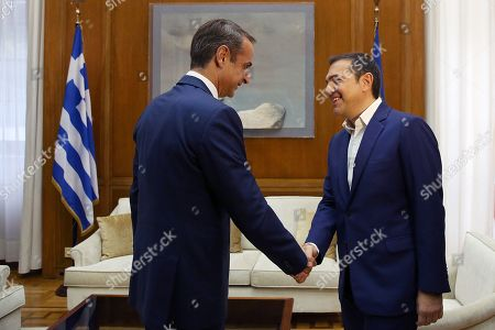 Stock Picture of Greek Prime Minister Kyriakos Mitsotakis (L) welcomes leader of SYRIZA Alexis Tsipras (R) during their meeting in Athens, Greece, 11 October 2019. Prime Minister Kyriakos Mitsotakis will have successive meetings with political leaders to discuss the voting rights of Greeks living abroad. Political leaders are also expected to discuss current developments such as the refugee/migrant issue and Turkish provocations in the Aegean and Cyprus.