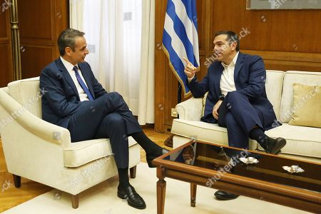 Stock Image of Greek Prime Minister Kyriakos Mitsotakis (L) speaks with leader of SYRIZA Alexis Tsipras(R) during their meeting in Athens, Greece, 11 October 2019. Prime Minister Kyriakos Mitsotakis will have successive meetings with political leaders to discuss the voting rights of Greeks living abroad. Political leaders are also expected to discuss current developments such as the refugee/migrant issue and Turkish provocations in the Aegean and Cyprus.