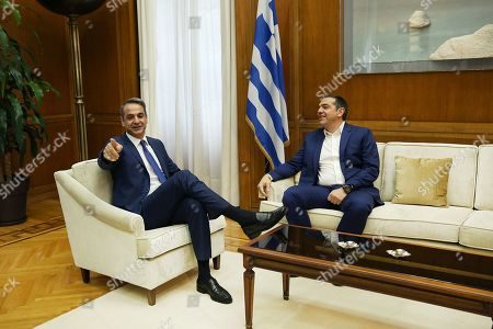 Greek Prime Minister Kyriakos Mitsotakis (L) speaks with leader of SYRIZA Alexis Tsipras(R) during their meeting in Athens, Greece, 11 October 2019. Prime Minister Kyriakos Mitsotakis will have successive meetings with political leaders to discuss the voting rights of Greeks living abroad. Political leaders are also expected to discuss current developments such as the refugee/migrant issue and Turkish provocations in the Aegean and Cyprus.