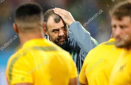 Australia coach Michael Cheika watches as his players warm up ahead of the Rugby World Cup Pool D game at Shizuoka Stadium Ecopa between Australia and Georgia in Shizuoka, Japan, Friday, Oct.11, 2019