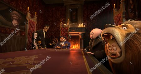 Stock Image of Morticia Addams (Charlize Theron), Lurch (Conrad Vernon), Gomez Addams (Oscar Isaac), Uncle Fester (Nick Kroll) and Pugsley Addams (Finn Wolfhard)