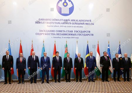 (L-R) Azerbaijan's President Ilham Aliyev, Armenian President Armen Sargsyan, Belarus President Alexander Lukashenko, Kazakhstan's President Kassym-Jomart Tokayev, Kyrgyzstan's President Sooronbay Jeenbekov, Turkmenistan's President Gurbanguly Berdymukhamedov, Russian President Vladimir Putin, Moldovan President Igor Dodon, Tajik President Emomali Rahmon, Uzbek President Shavkat Mirziyoyev and CIS Executive Secretary Sergei Lebedev pose for a family photo during CIS summit in Ashgabat, Turkmenistan, 11 October 2019. The CIS leaders meet in Ashgabat to review trade, economic, social, foreign policy and security cooperation of their countries.