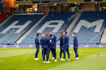 Charlie Mulgrew & his Scotland team mates chat on the pitch shortly after arriving at Hampden Park.