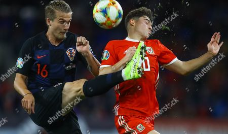 Tin Jedvaj of Croatia and Daniel James of Wales in action