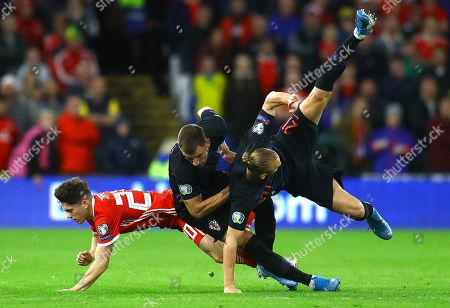 Daniel James of Wales goes down injured after this challenge from Domagoj Vida of Croatia