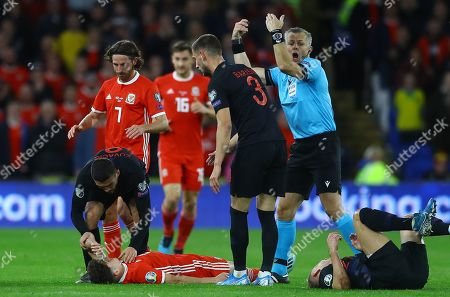 Stock Image of Daniel James of Wales goes down injured after a challenge from Domagoj Vida of Croatia