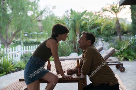 Natalie Portman as Lucy Cola and Jon Hamm as Mark Goodwin