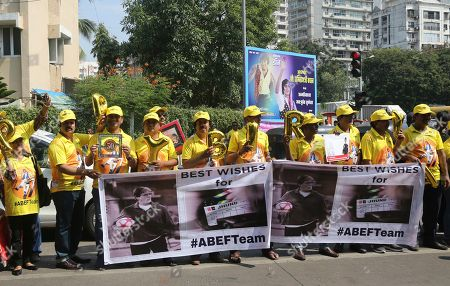 Fans stand outside the residence of Bollywood superstar Amitabh Bachchan to celebrate his 77th birthday in Mumbai, . Bachchan turned 77 on Friday