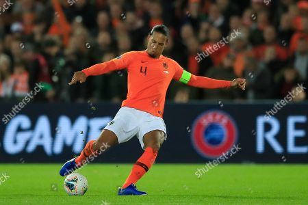 Netherlands' Virgil van Dijk passes the ball during the Euro 2020 group C qualifying soccer match between The Netherlands and Northern Ireland at De Kuip stadium in Rotterdam, Netherlands