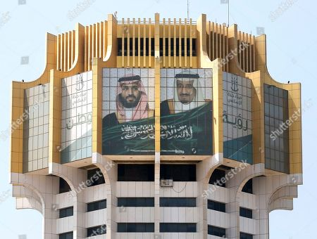 A banner showing Saudi King Salman, right, and Crown Prince Mohammed bin Salman, hangs at the watching tower of the Red Sea port city of Jiddah, Saudi Arabia, . Iranian officials say two missiles struck an Iranian tanker traveling through the Red Sea off the coast of Saudi Arabia