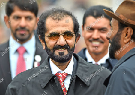 Stock Photo of Sheikh Mohammad Bin Rashid Al Maktoum, owner of Godolphin after their horse Pinatubo had won The Darley Dewhurst Stakes.