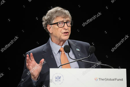 Philanthropist and Co-Chairman of the Bill & Melinda Gates Foundation Bill Gates gestures as he speaks to the audience during the Global Fund to Fight AIDS event at the Lyon's congress hall, central France, . French President Emmanuel Macron said the conference of the Global Fund to fight against AIDS, tuberculosis and malaria raised at least $13.92 billion for the next three years