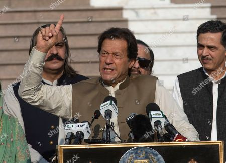 Pakistan's Prime Minister Imran Khan addresses a rally to express solidarity with Indian Kashmiris, in Islamabad, Pakistan, . Tensions between Pakistan and India, two nuclear-armed countries, has increased since Aug. 5, when India downgraded the autonomy of its side of Kashmir and imposed tighter controls on the area