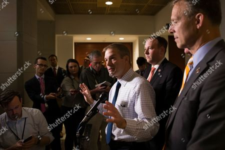 Lee Zeldin, Scott Perry, Jim Jordan. Rep. Jim Jordan, R-Ohio, left, speaks with reporters accompanied by Rep. Lee Zeldin, R-N.Y., and Rep. Scott Perry, R-Pa., right, as they depart after a meeting with former U.S. ambassador to Ukraine, Marie Yovanovitch, on Capitol Hill, in Washington