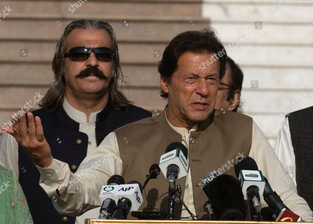 Pakistani Prime Minister Imran Khan addresses a Kashmir rally in Islamabad, Pakistan, . Pakistan's foreign minister says Prime Minister Imran Khan will travel to Iran's capital Saturday before traveling on to Saudi Arabia as part of his efforts to ease tensions between the two Islamic countries