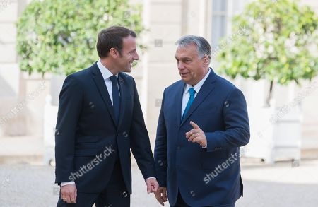 French President Emmanuel Macron welcomes Hungary's Prime minister Viktor Orban at Elysee palace.