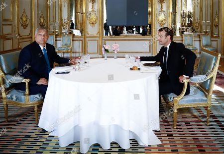 French President Emmanuel Macron attends a lunch meeting with Hungarian Prime Minister Viktor Orban at the Elysee presidential palace.