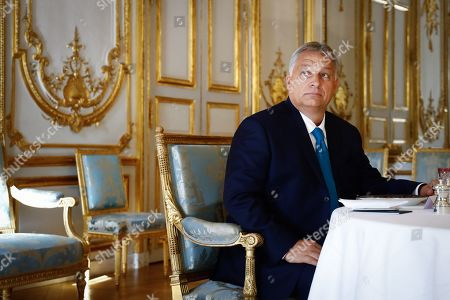 Hungarian Prime Minister Viktor Orban attends a lunch meeting with the French President at the Elysee presidential palace.