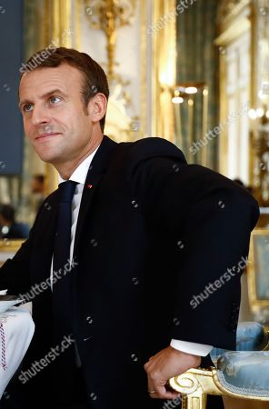 French President Emmanuel Macron attends a lunch meeting with Hungarian Prime Minister at the Elysee presidential palace.