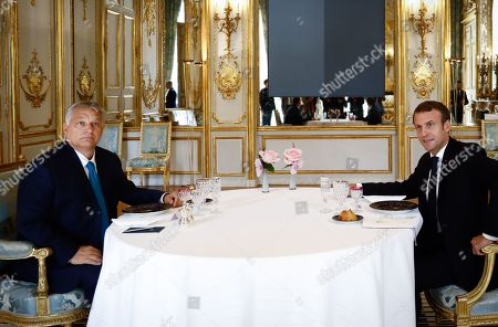 Stock Photo of French President Emmanuel Macron attends a lunch meeting with Hungarian Prime Minister Viktor Orban at the Elysee presidential palace.