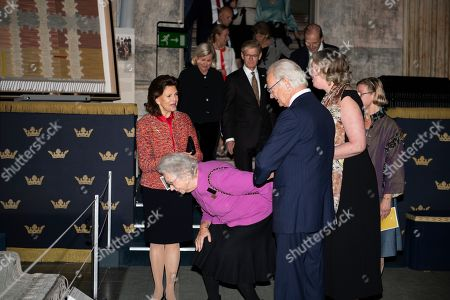 King Carl Gustaf, Queen Silvia and Princess Christina at the opening of the exhibition about carpet designer Marta Maas-Fjetterstrom at the Royal Palace in Stockholm