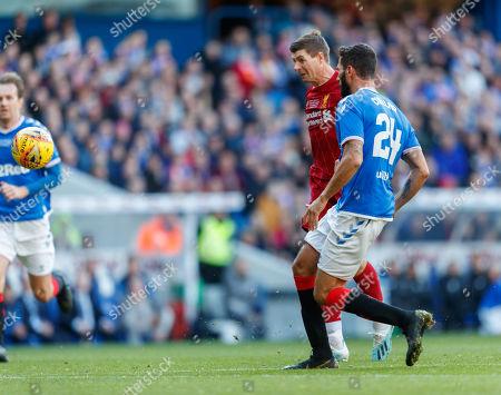 Steven Gerrard of Liverpool tries to chip the ball over Rangers goalkeeper Neil Alexander