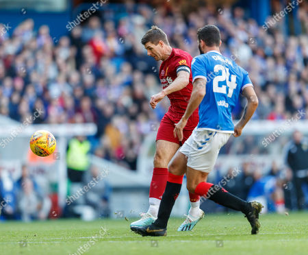Stock Photo of Steven Gerrard of Liverpool tries to chip the ball over Rangers goalkeeper Neil Alexander