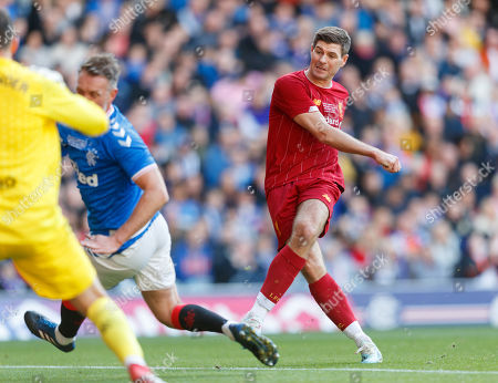 Stock Picture of Steven Gerrard of Liverpool sees his shot blocked by Clint Hill of Rangers