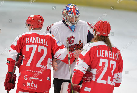 Petr Cech of Guildford Phoenix shake hands at the end of the match