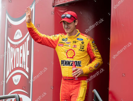 Joey Logano (22) walks on to the stage during driver introductions at the Drydene 400 - Monster Energy NASCAR Cup Series playoff auto race, at Dover International Speedway in Dover, Del