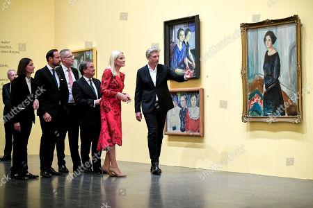 Stock Photo of Norwegian Crown Princess Mette-Marit (2-R) and her husband Crown Prince Haakon (3-L) attend the joint opening of the Edvard Munch exhibition with North Rhine-Westphalian Prime Minister Armin Laschet (3-R) at K20 museum in Duesseldorf, Germany, 11 October 2019. The North Rhine-Westphalian art collection presents 140 unknown works by Norwegian painter Edvard Munch that have rarely if ever been exhibited in Germany. The exhibition runs from 15 October 2019 to 01 March 2020.