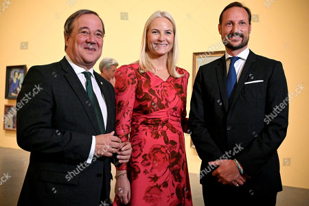 Norwegian Crown Princess Mette-Marit (C) and her husband Crown Prince Haakon (R) attend the joint opening of the Edvard Munch exhibition with North Rhine-Westphalian Prime Minister Armin Laschet (L) at K20 museum in Duesseldorf, Germany, 11 October 2019. The North Rhine-Westphalian art collection presents 140 unknown works by Norwegian painter Edvard Munch that have rarely if ever been exhibited in Germany. The exhibition runs from 15 October 2019 to 01 March 2020.