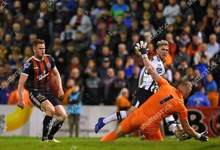 Stock Image of Bohemians vs Dundalk. Bohemians James Talbot saves from Sean Murray of Dundalk