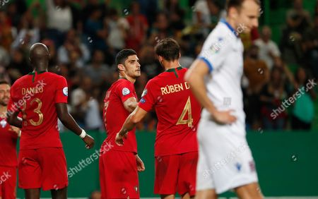 Stock Image of Portugal's Goncalo Guedes, third from right, celebrates with his teammate Ruben Dias, second from right, and Danilo Pereira after scoring his side's third goal during the Euro 2020 group B qualifying soccer match between Portugal and Luxembourg at the Jose Alvalade stadium in Lisbon