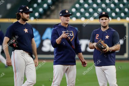 Gerrit Cole, AJ Hinch, Alex Bregman. Houston Astros starting pitcher Gerrit Cole, left, manager AJ Hinch, center, and third baseman Alex Bregman, right, talk during a practice for a baseball American League Championship Series in Houston, . Houston will face the New York Yankees, Saturday