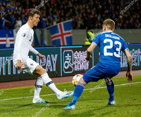 Iceland France Euro 2020 Soccer. France's Benjam­in Pav­ard, left, is challenged by Iceland's Ari Skulason, right, during the Euro 2020 group H qualifying soccer match between Iceland and France at Laugardalsvollur stadium in Reykjavik, Iceland