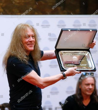 Janick Gers, member of British heavy metal band Iron Maiden, shows a plaque after receiving it during a tribute to the band by the Argentinian Congress, in Buenos Aires, Argentina, 11 October 2019. The band members were named 'visitors of honor' by the Chamber of Deputies of Argentina, on the eve of a concert they will offer in Buenos Aires. The act of homage, which took place in the Hall of Lost Steps of the Congress, consisted of the delivery of six plates, one to each musician, and was attended by members of the group, as well as musicians related to the heavy local and specialized media.