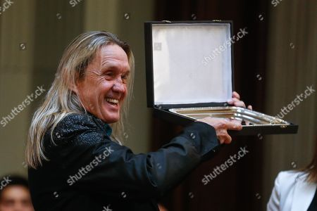 Nicko McBrain, guitarist of British heavy metal band Iron Maiden, shows a plaque after receiving it during a tribute to the band by the Argentinian Congress, in Buenos Aires, Argentina, 11 October 2019. The band members were named 'visitors of honor' by the Chamber of Deputies of Argentina, on the eve of a concert they will offer in Buenos Aires. The act of homage, which took place in the Hall of Lost Steps of the Congress, consisted of the delivery of six plates, one to each musician, and was attended by members of the group, as well as musicians related to the heavy local and specialized media.