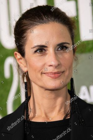 """Livia Firth poses for photographers upon arrival at the premiere of the film """"Western Stars"""" which is screened as part of the London Film Festival, in central London"""