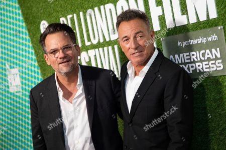 Bruce Springsteen, Thom Zimny. Musician and director Bruce Springsteen, right, and producer Thom Zimny pose for photographers upon arrival at the premiere of the film 'Western Stars' which is screened as part of the London Film Festival, in central London