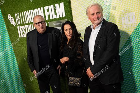 Jon Landau, Barbara Carr, George Travis. Jon Landau, Barbara Carr and George Travis pose for photographers upon arrival at the premiere of the film 'Western Stars' which is screened as part of the London Film Festival, in central London