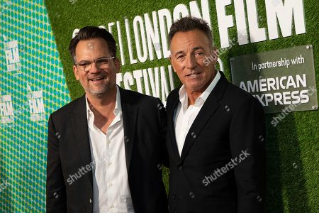 "Bruce Springsteen, Thom Zimny. Musician and director Bruce Springsteen, right, and producer Thom Zimny pose for photographers upon arrival at the premiere of the film ""Western Stars"" which is screened as part of the London Film Festival, in central London"