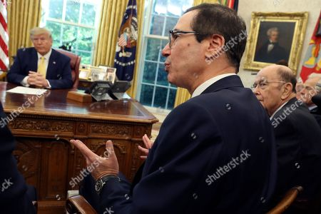 Treasury Secretary Steven Mnuchin speaks as Commerce Secretary Wilbur Ross, right, listens with President Donald Trump during their meeting with Vice Premier Liu He in the Oval Office of the White House in Washington