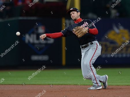 Washington Nationals shortstop Trea Turner throws to Washington Nationals first baseman Ryan Zimmerman to get St. Louis Cardinals Yadier Molina to ground out during the bottom of the fifth inning of the MLB National League Championship Series playoff baseball game one between the Washington Nationals and the St. Louis Cardinals at Busch Stadium in St. Louis, Missouri, USA, 11 October 2019.