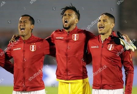 Peru's Renato Tapia, left, goalkeeper Pedro Gallese and Paolo Guerrero sing the national anthem before the start of a friendly soccer match against Uruguay, in Montevideo, Uruguay