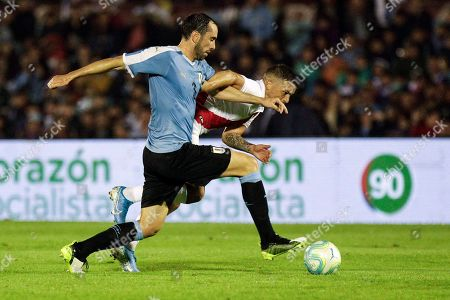 Stock Image of Uruguay's Diego Godin, left front, and Peru's Paolo Guerrero, fight for control of the ball during a friendly soccer match, in Montevideo, Uruguay